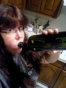 Image of Nicola Cameron drinking heartily from a bottle of Lucid Absinthe Supérieure